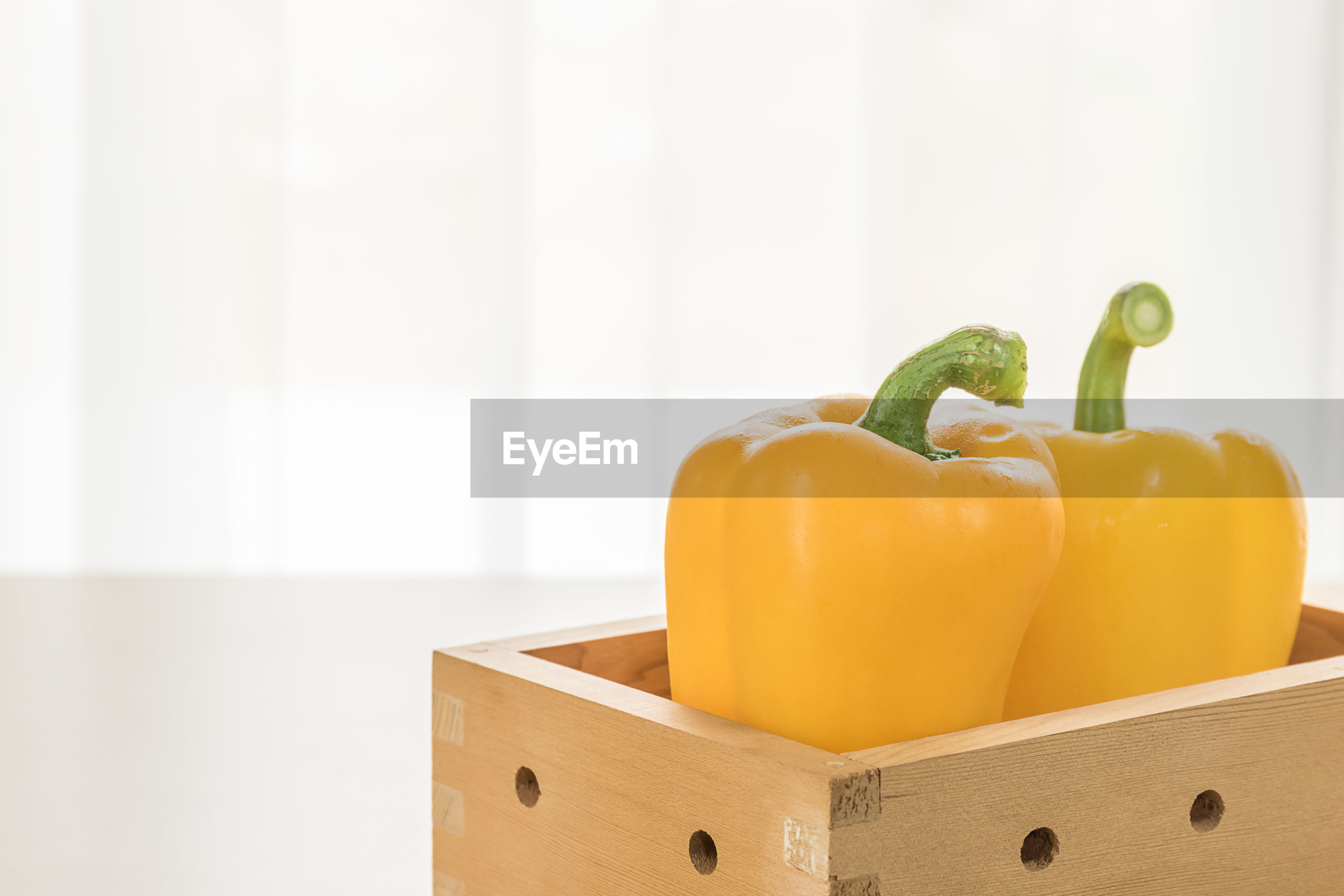 Close-up of yellow bell peppers on table