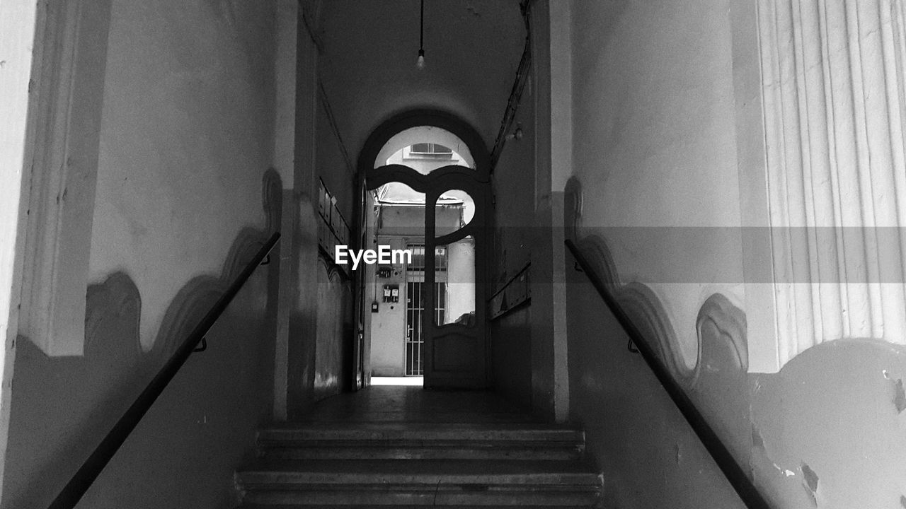 architecture, built structure, building, staircase, the way forward, indoors, direction, steps and staircases, arch, no people, railing, wall - building feature, day, arcade, low angle view, corridor, door, entrance, history, ceiling