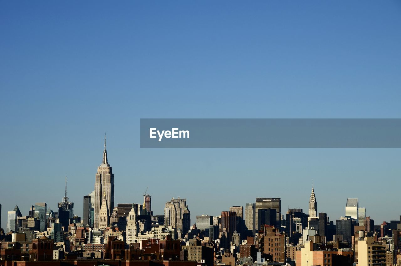 High Angle View Of Cityscape Against Blue Sky