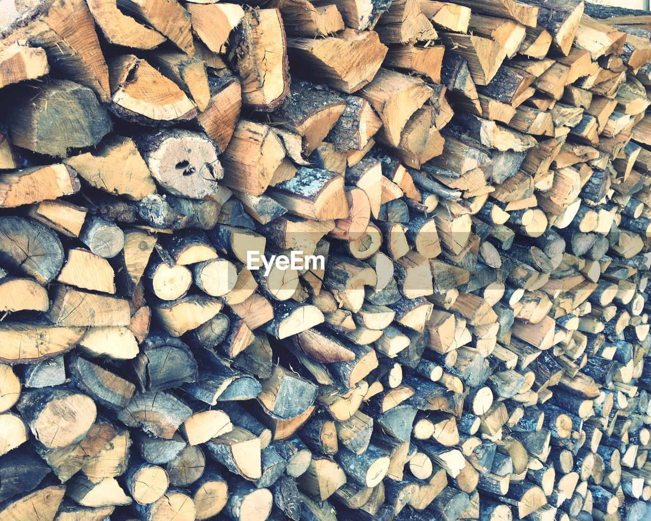 firewood, stack, woodpile, log, timber, abundance, large group of objects, forestry industry, heap, lumber industry, deforestation, backgrounds, fossil fuel, full frame, wood - material, textured, pile, fuel and power generation, no people, day, close-up, outdoors