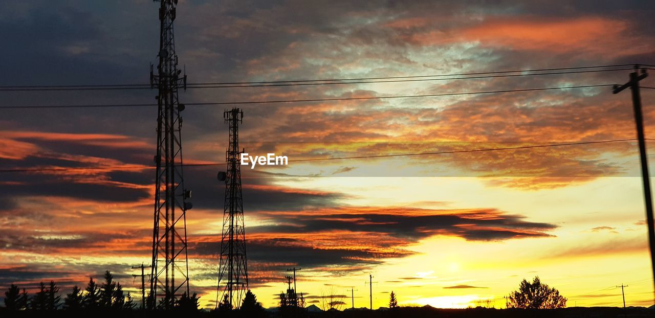 cable, sunset, cloud - sky, power line, silhouette, electricity pylon, electricity, power supply, sky, connection, fuel and power generation, orange color, dramatic sky, low angle view, technology, no people, outdoors, nature, scenics, complexity, beauty in nature, day
