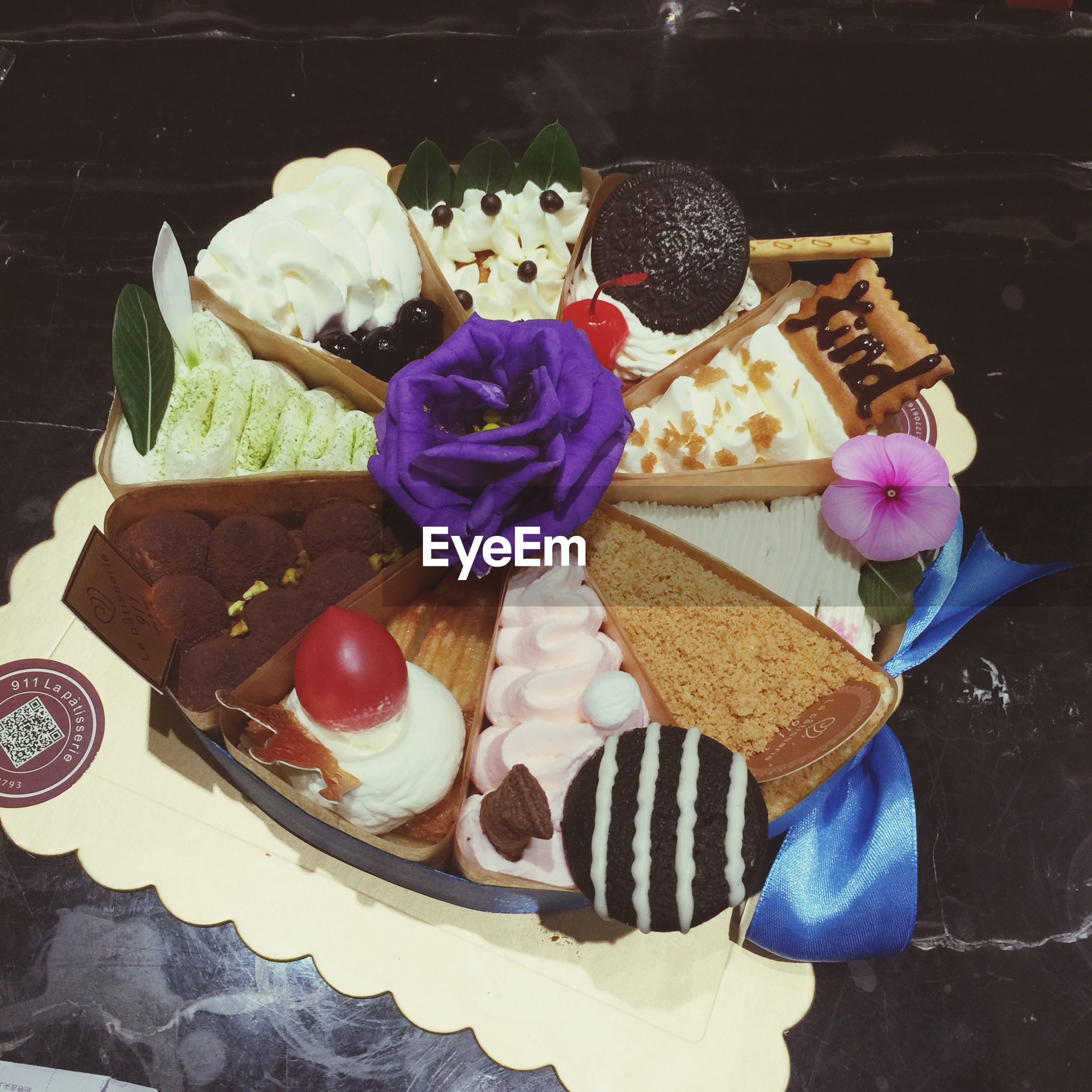 sweet food, freshness, dessert, food, food and drink, unhealthy eating, indulgence, still life, indoors, ready-to-eat, cake, temptation, table, flower, chocolate, high angle view, close-up, plate, cupcake, ice cream