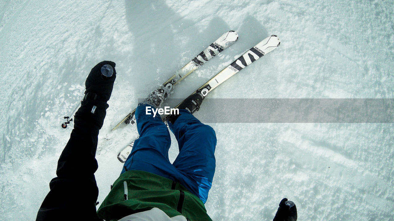 winter, cold temperature, sport, water, snow, one person, nature, high angle view, real people, low section, day, human leg, body part, leisure activity, human body part, winter sport, men, outdoors, warm clothing, human limb, human arm, arms raised