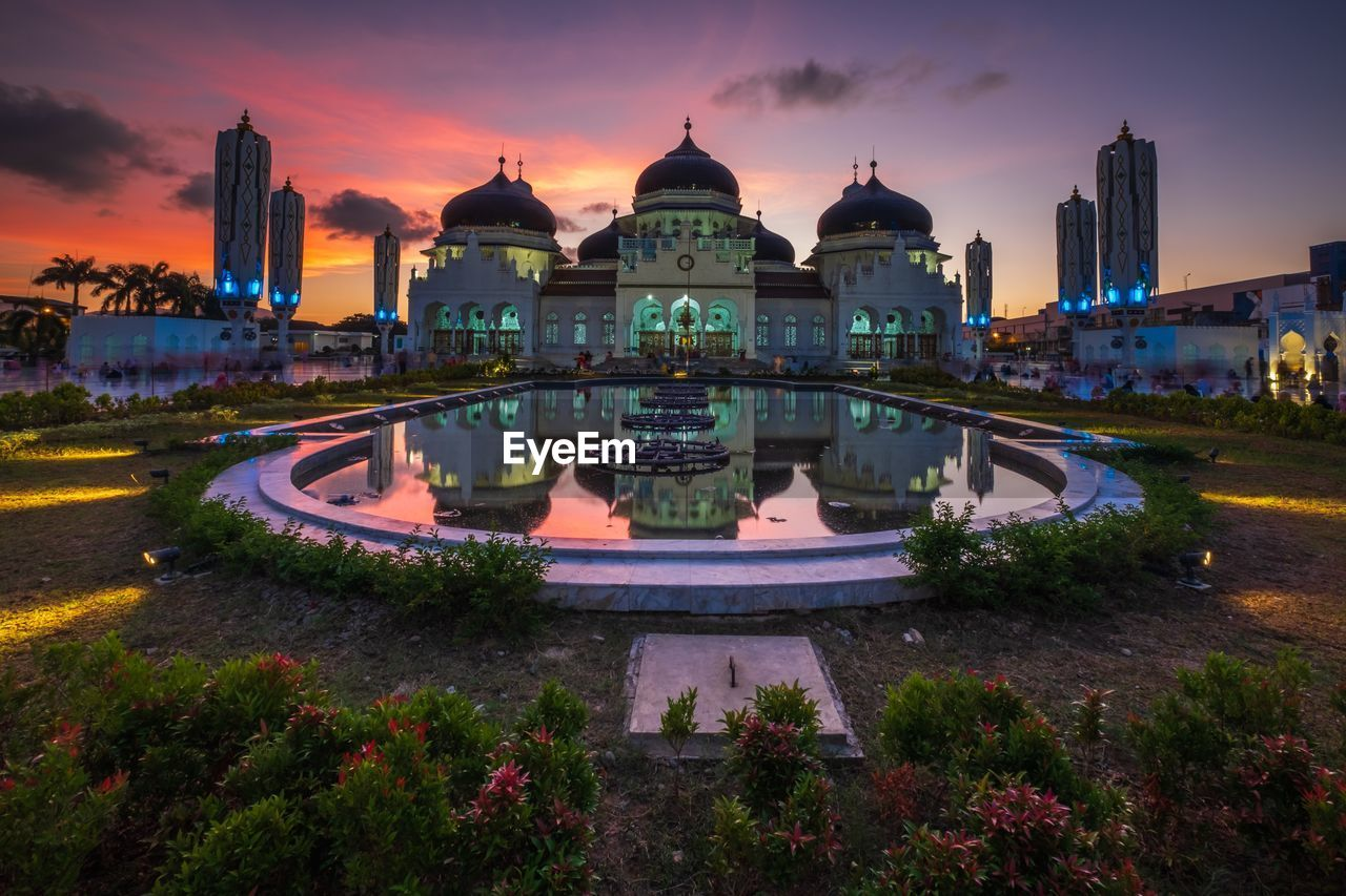 architecture, building exterior, built structure, sky, sunset, dome, water, building, travel destinations, religion, place of worship, tourism, nature, travel, spirituality, belief, city, the past, history, no people, outdoors, government