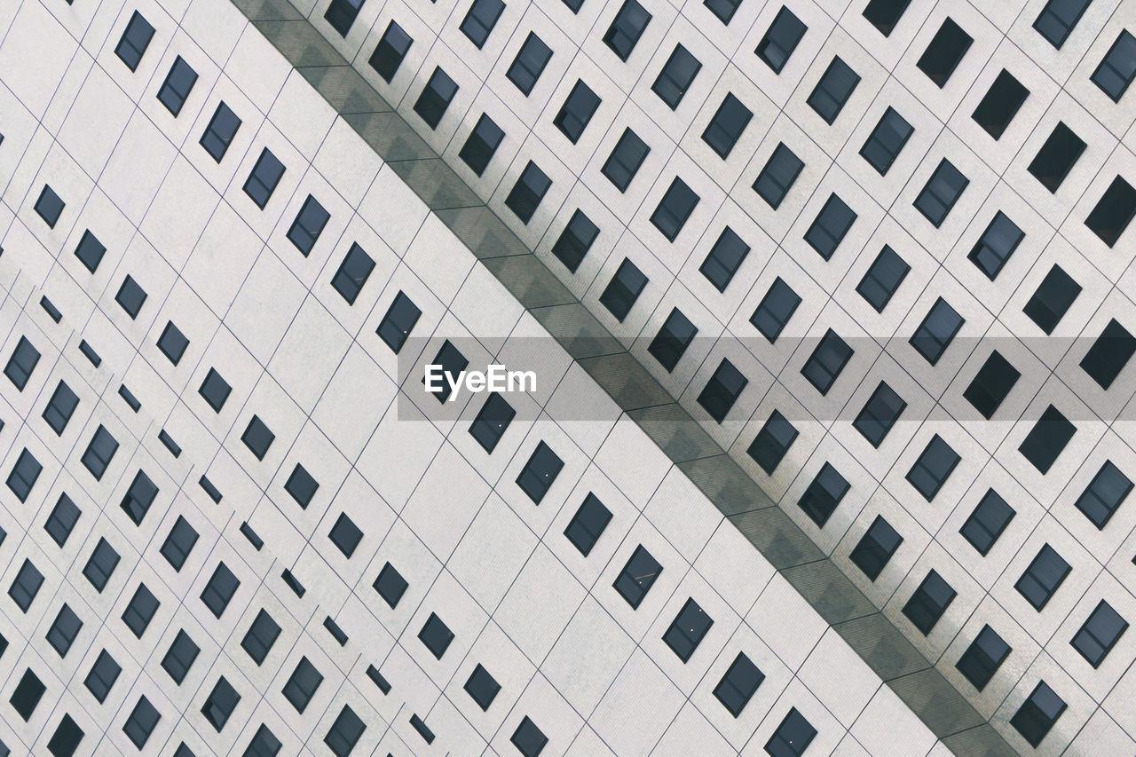 Tilt full frame image of building in city