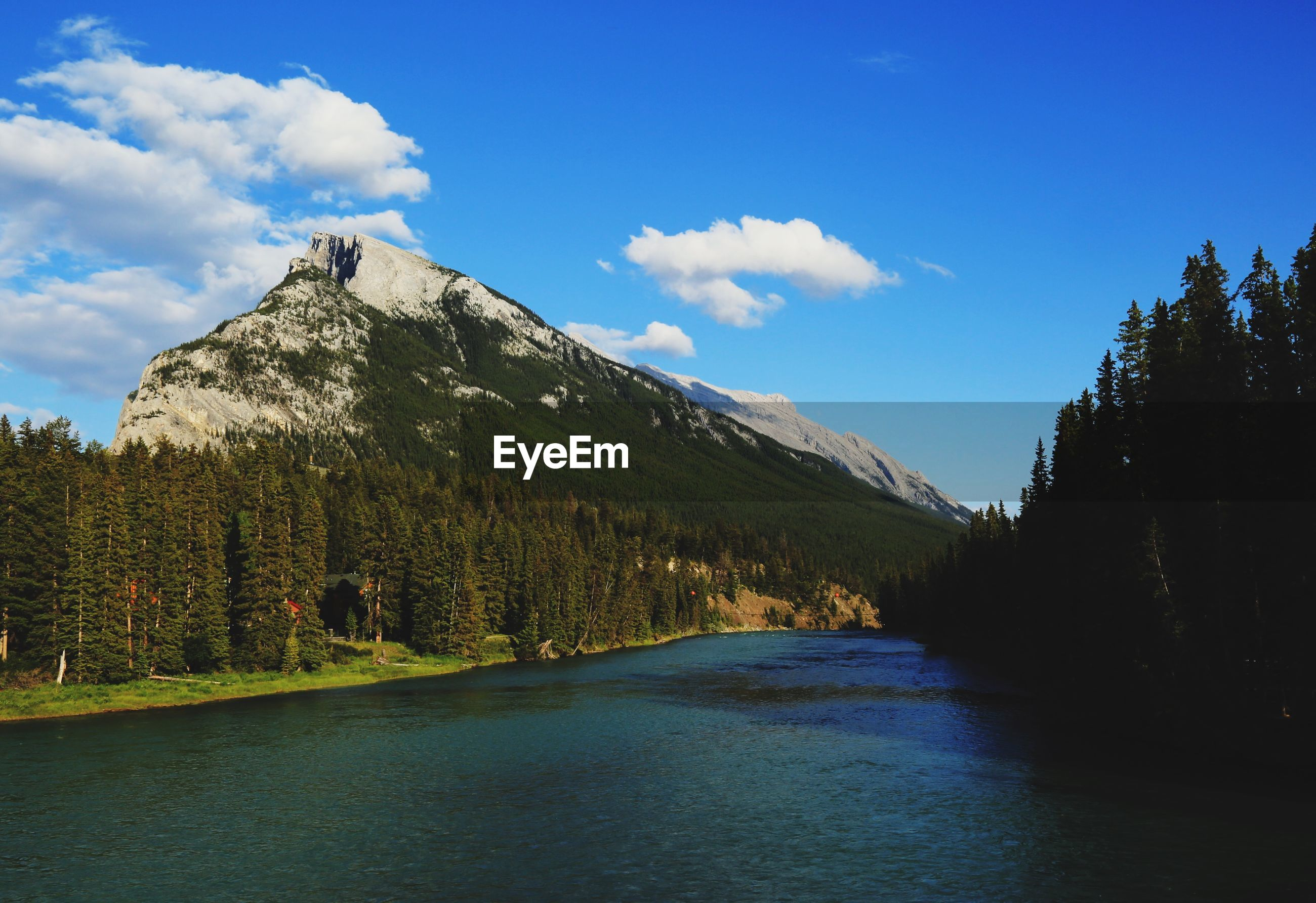 mountain, sky, tranquil scene, tranquility, scenics, water, beauty in nature, nature, blue, waterfront, tree, cloud - sky, mountain range, cloud, lake, idyllic, river, non-urban scene, day, landscape