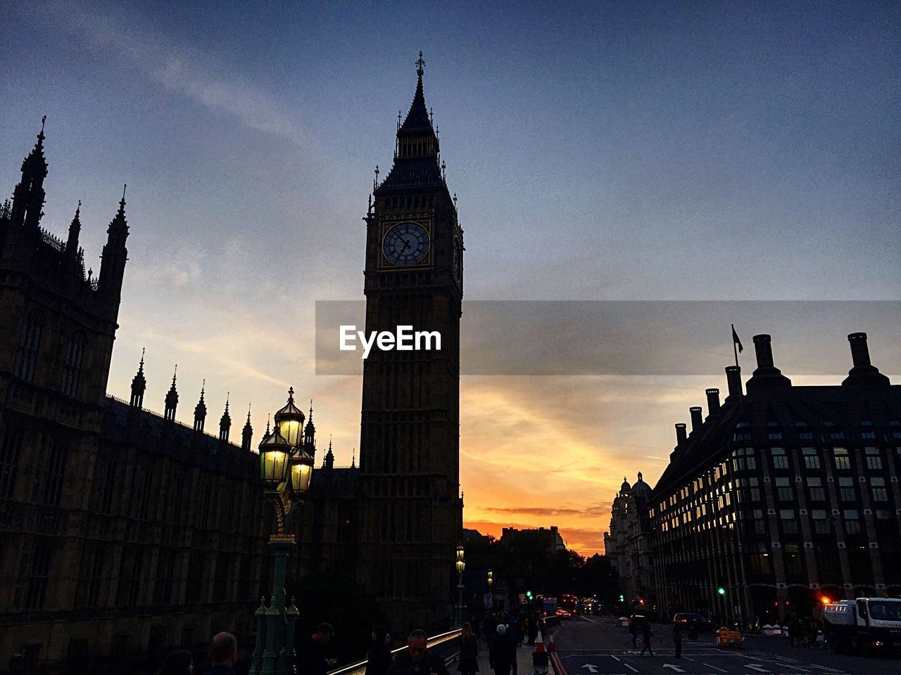 architecture, built structure, city, building exterior, sunset, sky, tourism, modern, travel destinations, outdoors, clock tower, people, day