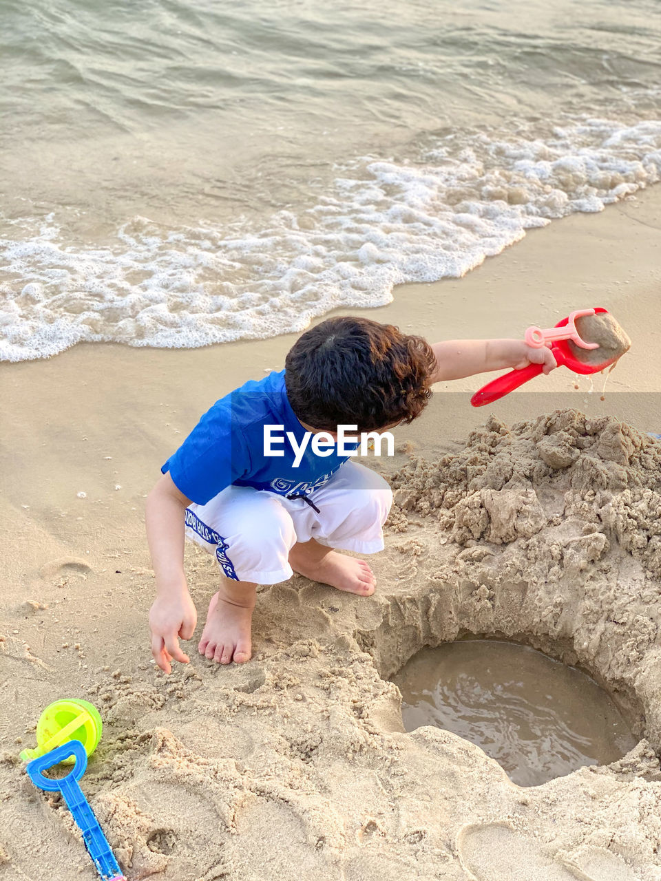 BOY ON SHORE AT BEACH