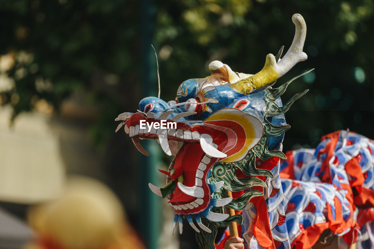 representation, animal representation, dragon, art and craft, creativity, focus on foreground, chinese dragon, multi colored, sculpture, craft, day, no people, close-up, celebration, chinese new year, statue, outdoors, festival