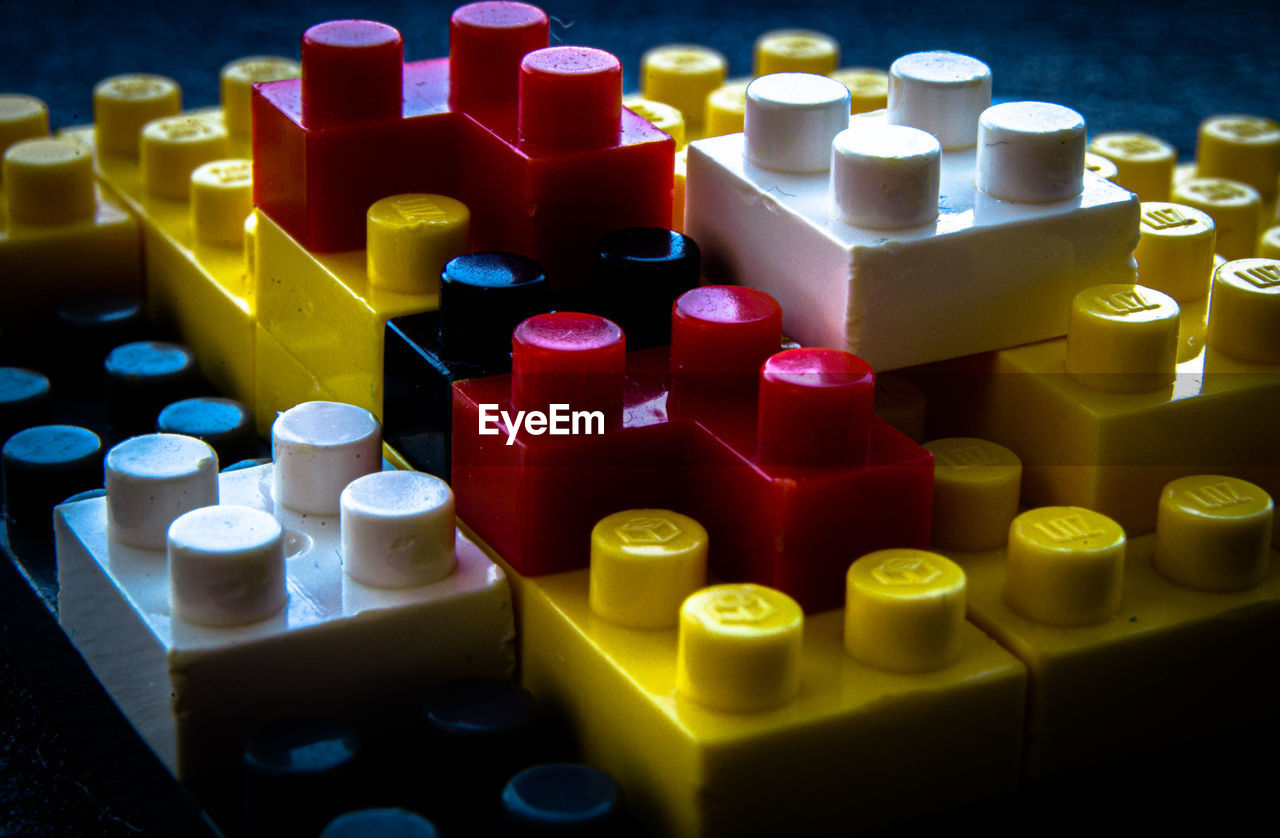 HIGH ANGLE VIEW OF MULTI COLORED TOY ON SHELF