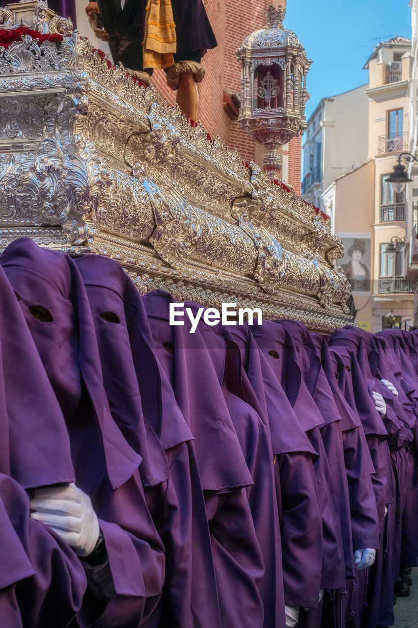 clothing, day, built structure, building exterior, architecture, real people, purple, incidental people, for sale, textile, large group of objects, choice, outdoors, retail, arrangement, small business, people, business, celebration, in a row
