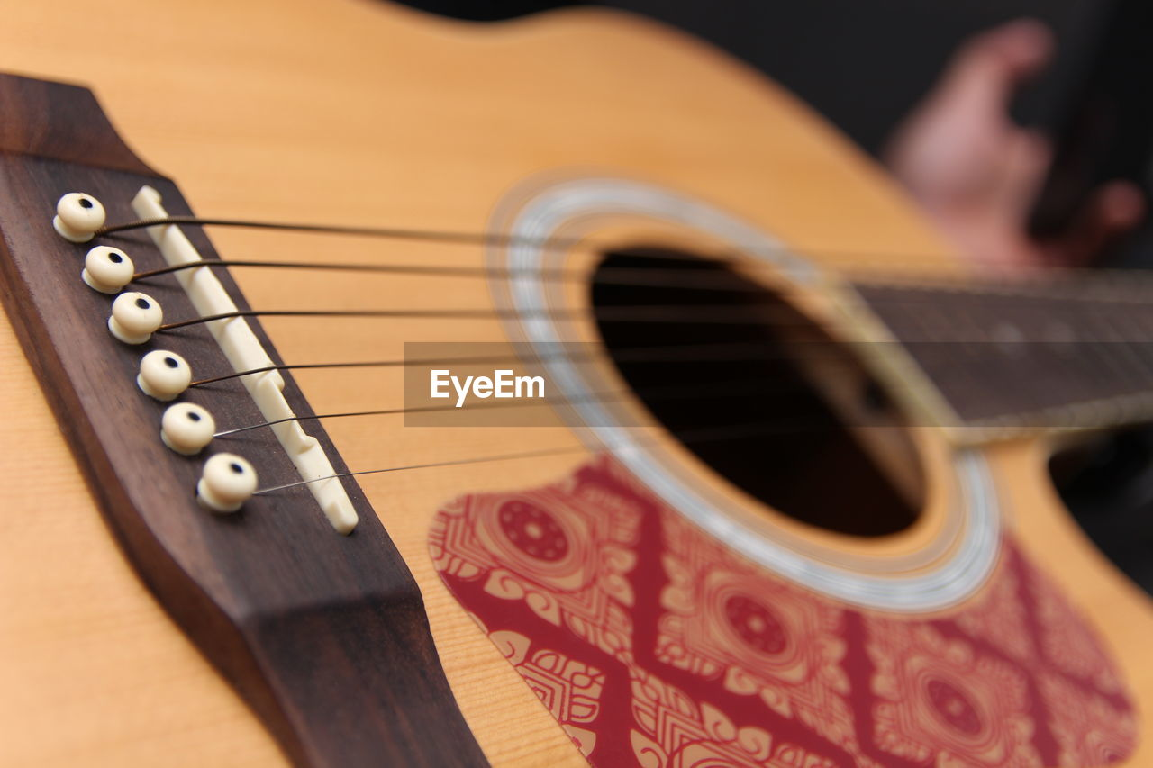 arts culture and entertainment, musical instrument, music, string instrument, string, musical instrument string, guitar, musical equipment, close-up, indoors, selective focus, wood - material, fretboard, acoustic guitar, still life, focus on foreground, no people, wind instrument, woodwind instrument, brown