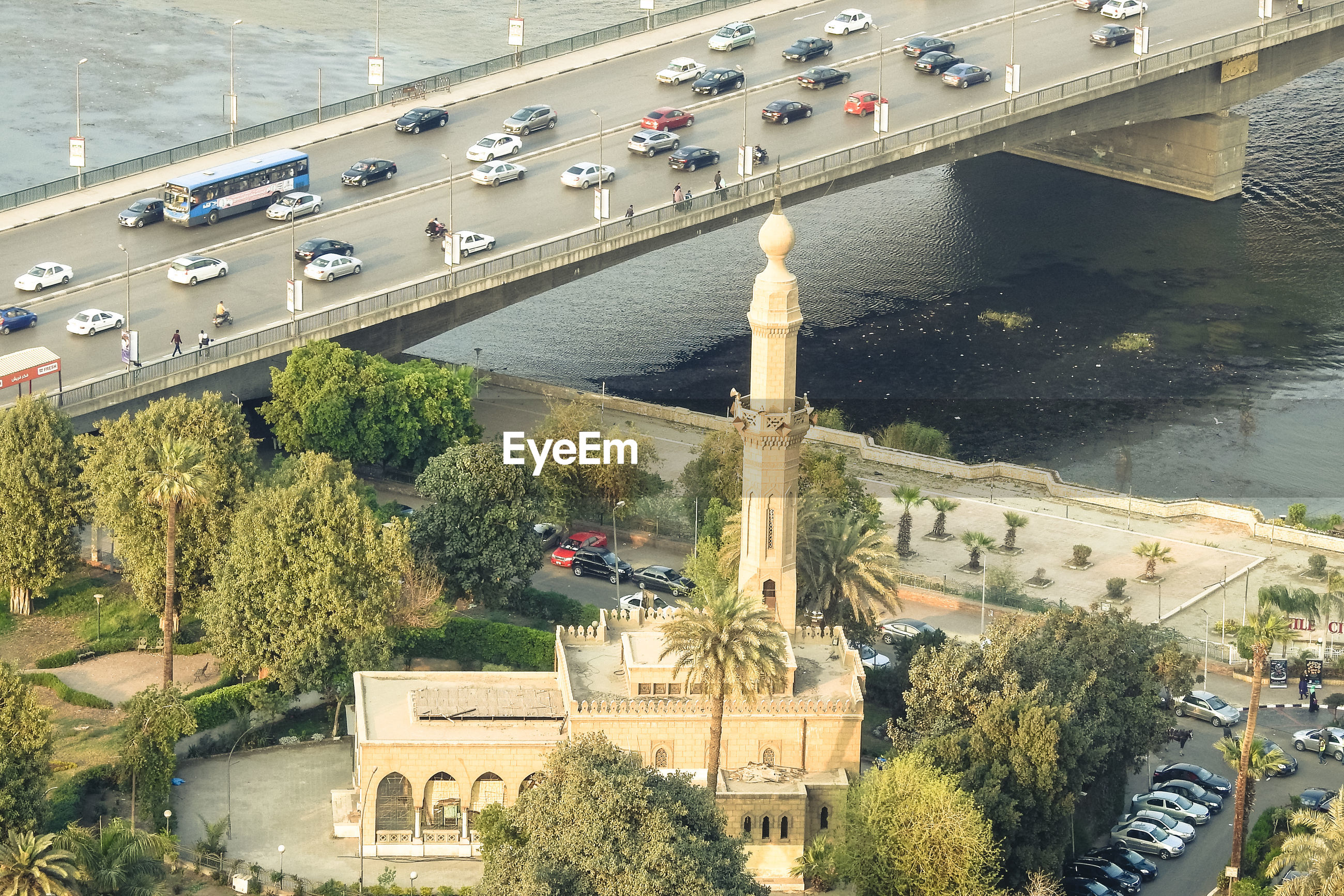 High angle view of minaret against bridge over river