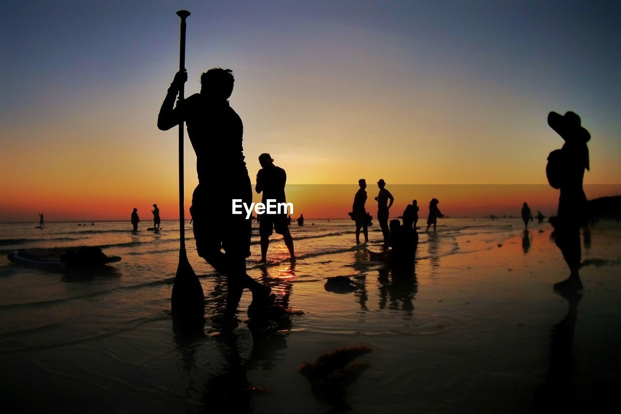 Silhouette People At Beach During Sunset