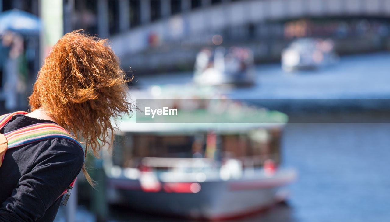 Woman With Redhead Looking At Ship