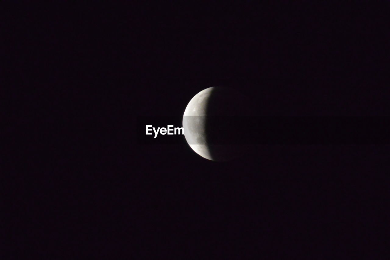 moon, astronomy, copy space, sky, space, night, beauty in nature, half moon, planetary moon, no people, tranquility, scenics - nature, nature, low angle view, tranquil scene, dark, crescent, moon surface, outdoors, idyllic, space and astronomy, eclipse, moonlight