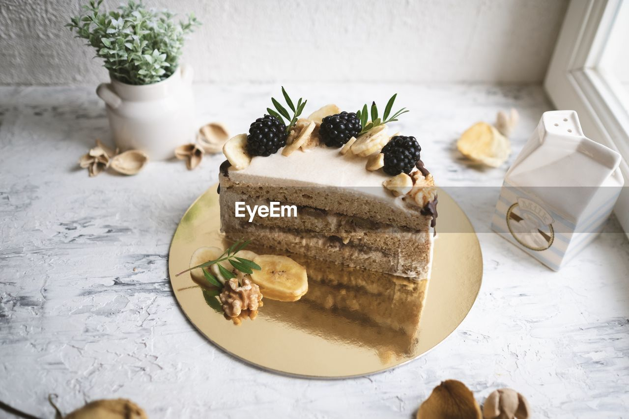 food, food and drink, freshness, table, still life, indoors, high angle view, indulgence, ready-to-eat, no people, plate, close-up, serving size, sweet food, dessert, sweet, unhealthy eating, temptation, bread, garnish