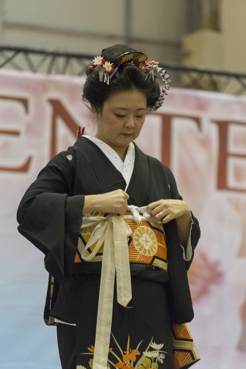 real people, one person, young adult, kimono, young women, front view, lifestyles, standing, women, day, outdoors, people