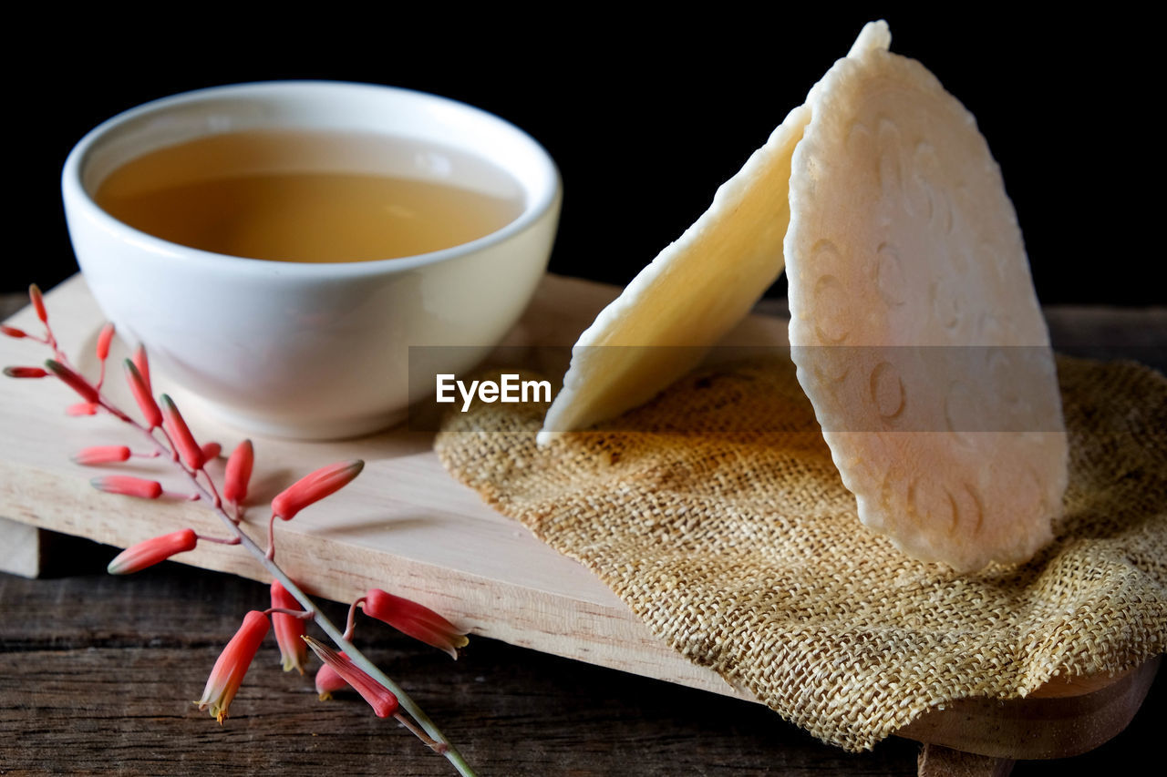 food and drink, food, freshness, indoors, cup, still life, table, wellbeing, healthy eating, drink, wood - material, close-up, tea - hot drink, refreshment, no people, tea, ready-to-eat, mug, hot drink, bread, tea cup, jute, crockery
