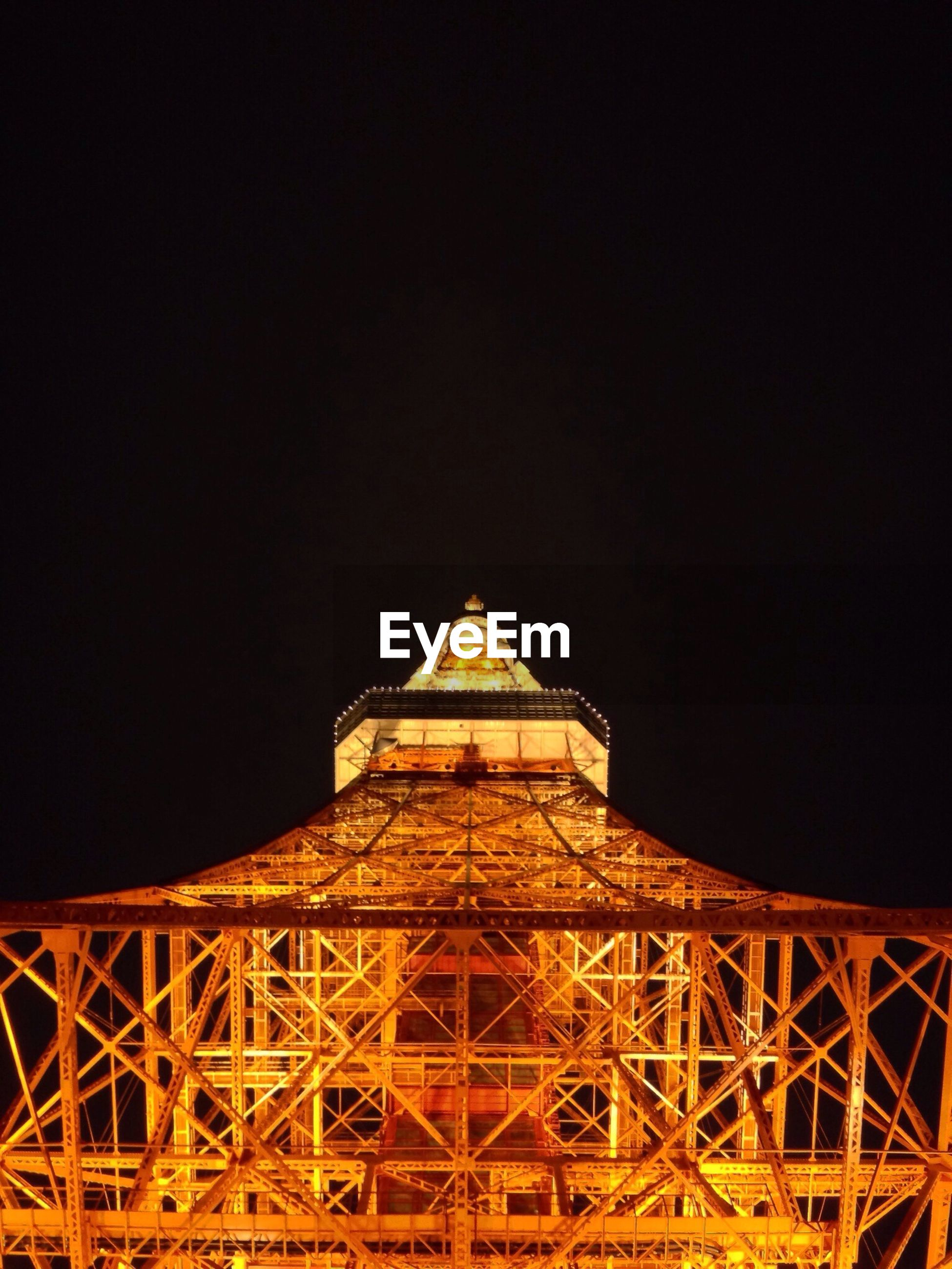 architecture, built structure, international landmark, famous place, clear sky, travel destinations, copy space, low angle view, tourism, night, eiffel tower, travel, capital cities, illuminated, tower, culture, history, metal, building exterior, engineering