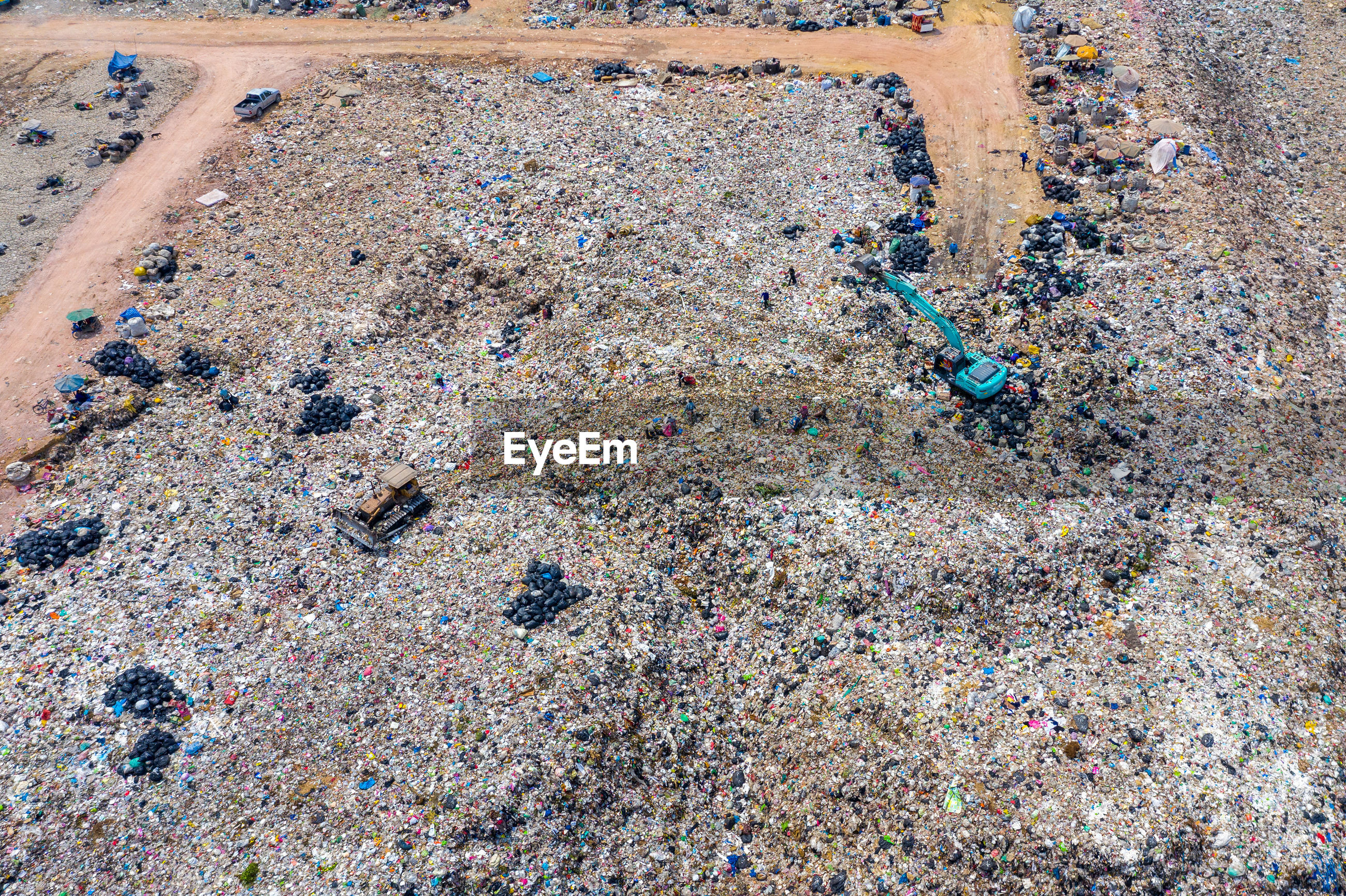 High angle view of land vehicle at garbage dump