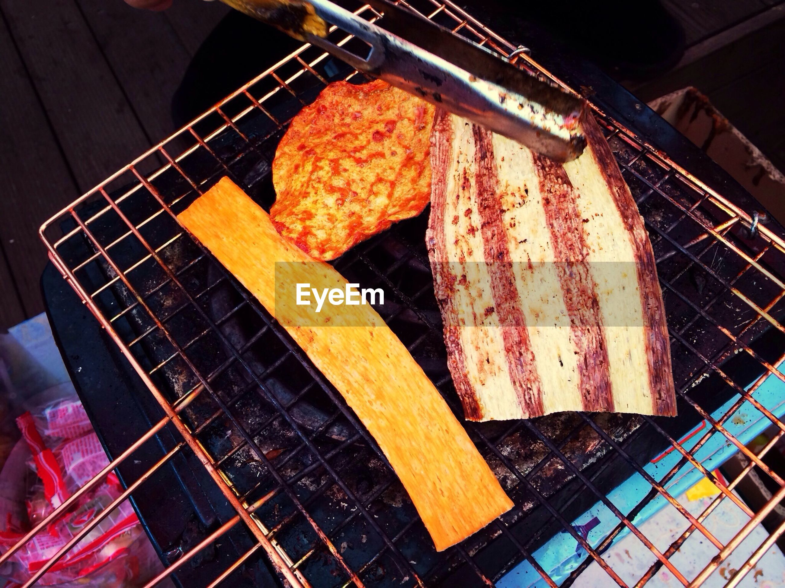 food, food and drink, indoors, high angle view, freshness, preparation, still life, barbecue grill, barbecue, meat, healthy eating, close-up, preparing food, cooking, no people, ready-to-eat, metal, grilled, sweet food