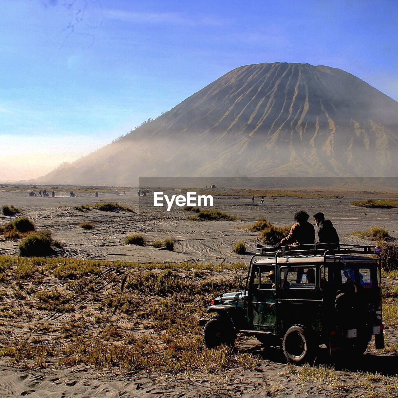 People In Off-Road Vehicle Against Mt Bromo
