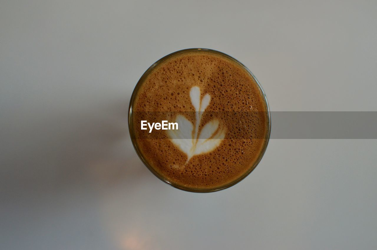food and drink, coffee, drink, refreshment, coffee - drink, still life, cup, close-up, frothy drink, coffee cup, no people, mug, indoors, freshness, directly above, studio shot, hot drink, shape, cappuccino, design, latte, non-alcoholic beverage