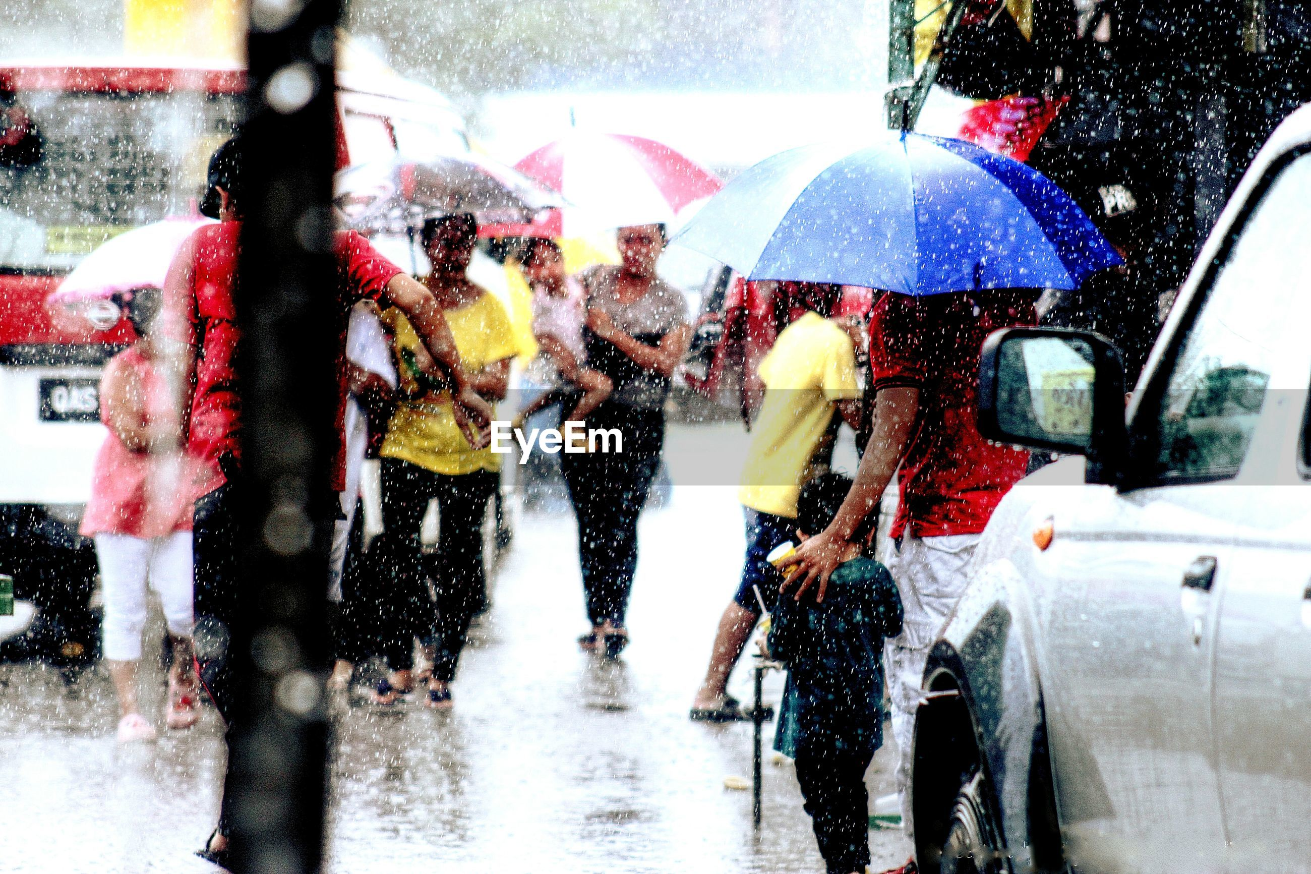 People on wet road during rainy season