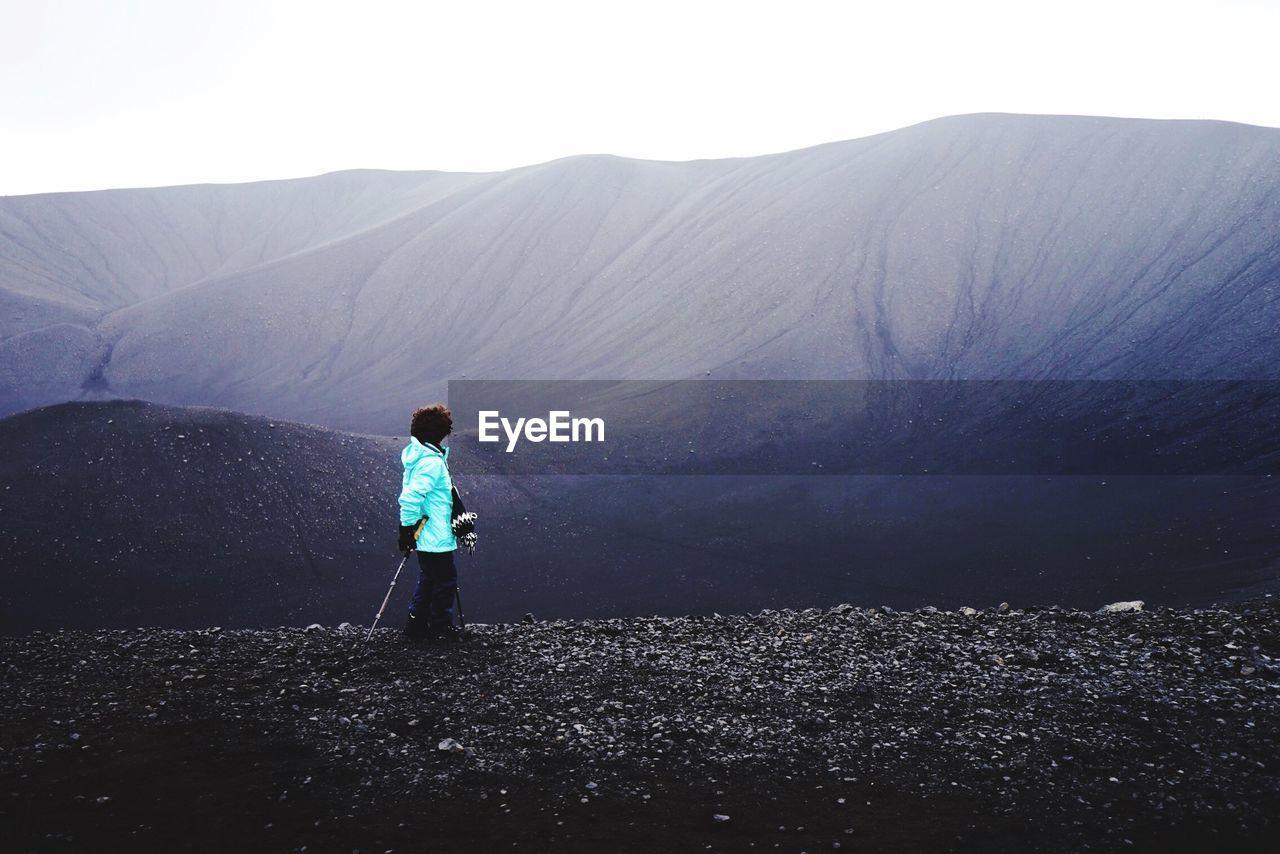Hiker Hiking On Volcanic Mountain