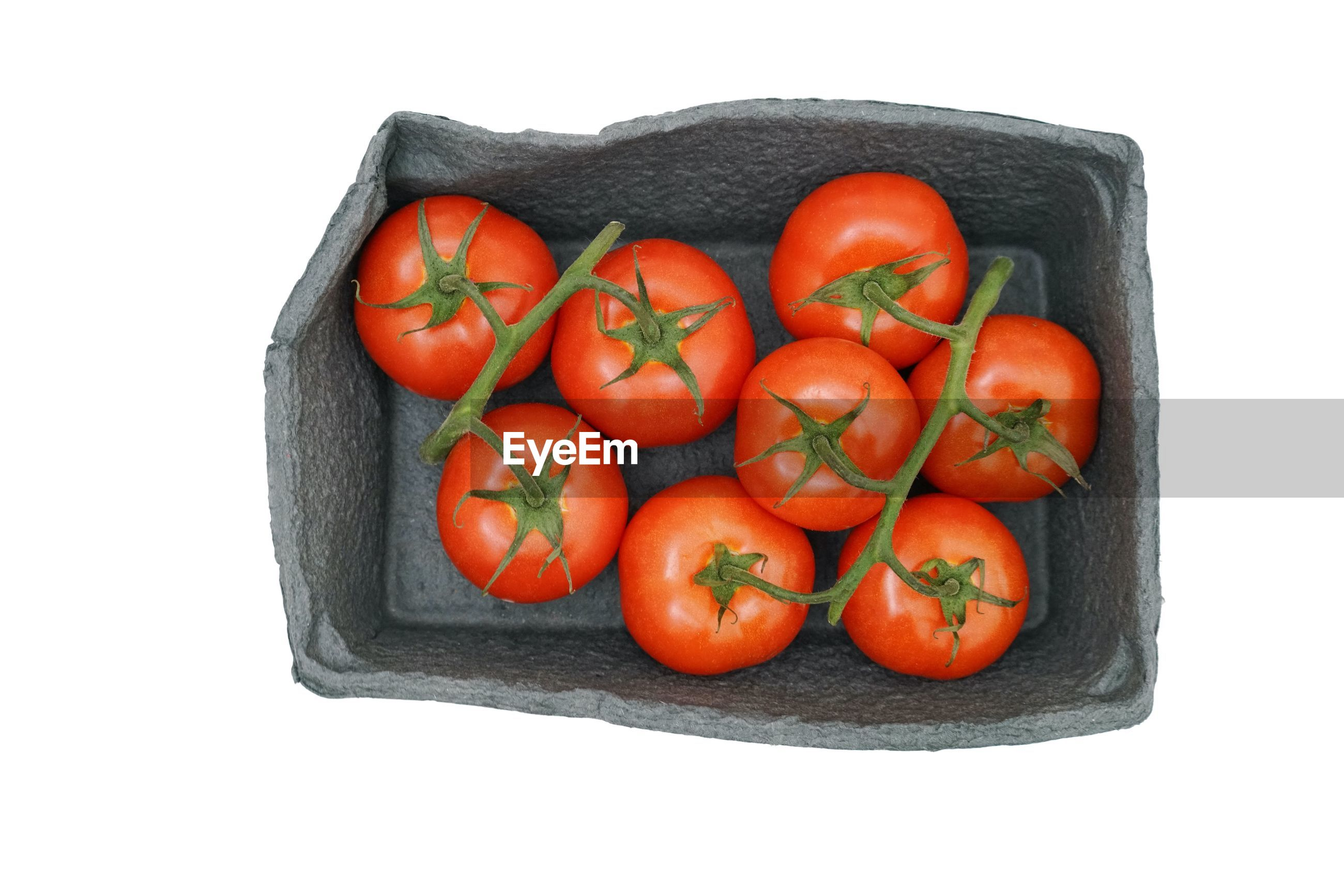 HIGH ANGLE VIEW OF TOMATOES AGAINST RED BACKGROUND