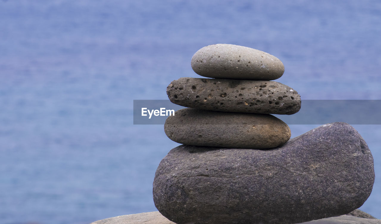 stack, balance, rock - object, stone - object, pebble, zen-like, in a row, stability, focus on foreground, arrangement, no people, close-up, tranquility, day, nature, water, outdoors, beauty in nature