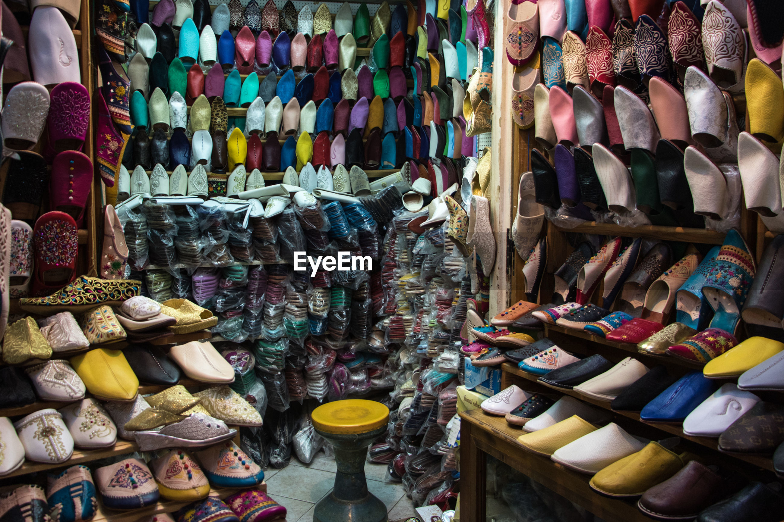 Multi colored shoes for sale at market stall