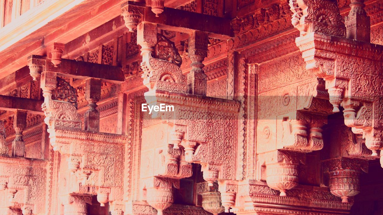 art and craft, religion, built structure, architecture, representation, belief, human representation, craft, sculpture, spirituality, history, the past, statue, creativity, place of worship, travel destinations, no people, low angle view, ancient, architectural column, ancient civilization, carving, ornate, ruined
