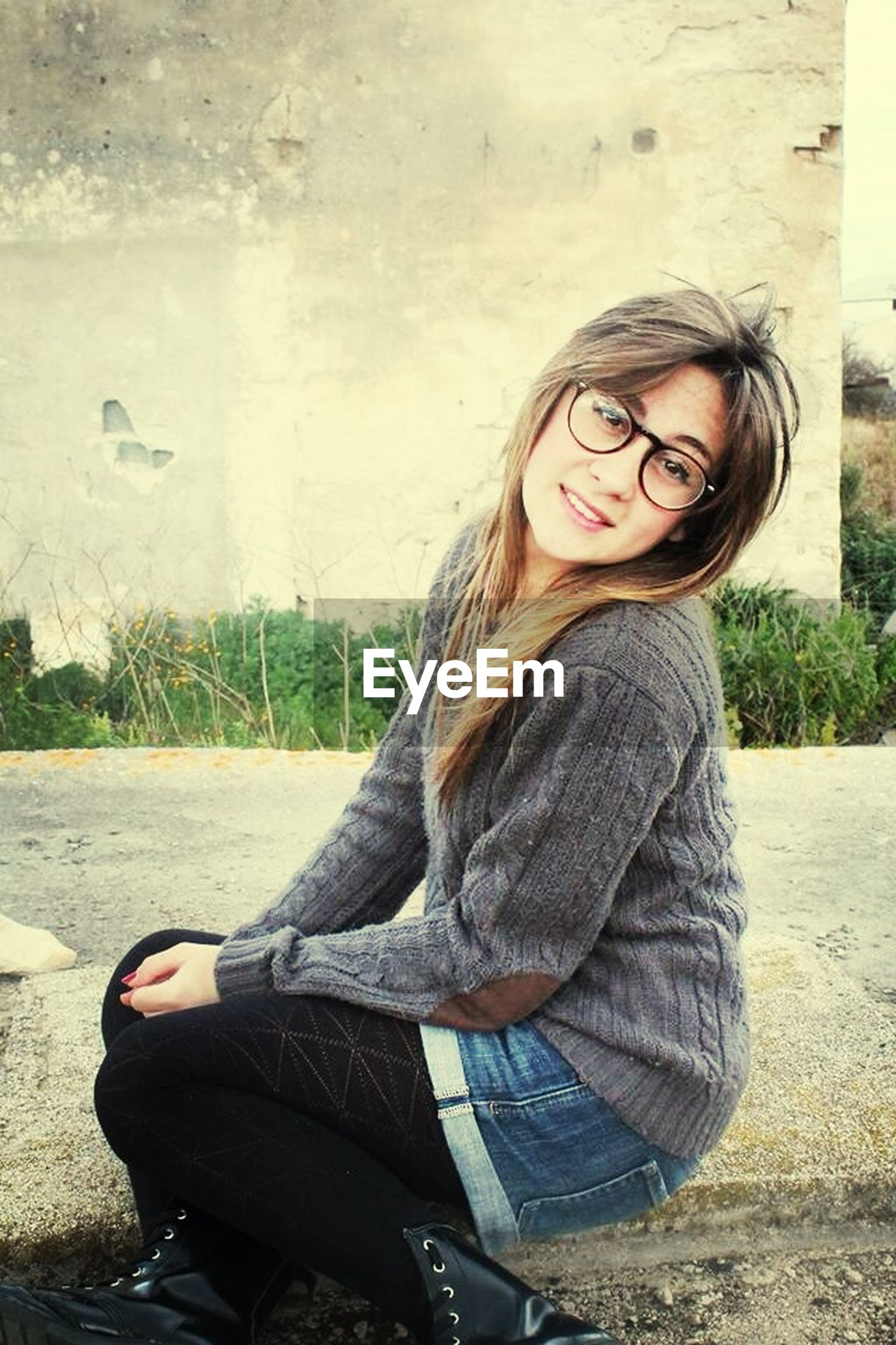 young adult, person, young women, portrait, casual clothing, lifestyles, looking at camera, leisure activity, smiling, front view, long hair, standing, sunglasses, three quarter length, sitting