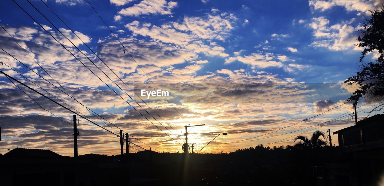 sky, cloud - sky, sunset, silhouette, nature, no people, beauty in nature, low angle view, tree, outdoors, scenics, cable, built structure, building exterior, architecture, day