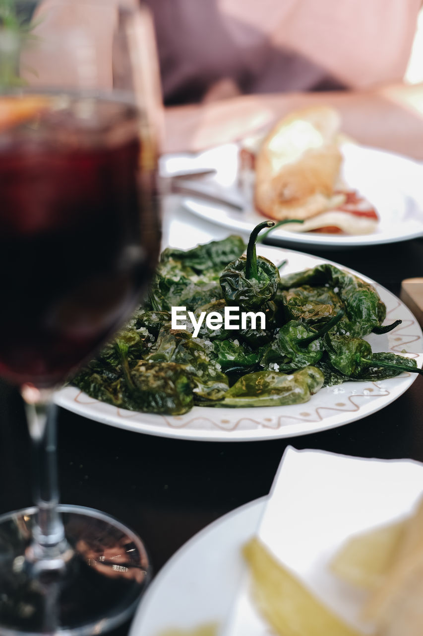 food and drink, food, freshness, plate, table, indoors, ready-to-eat, serving size, selective focus, healthy eating, close-up, wellbeing, meal, vegetable, no people, still life, business, restaurant, refreshment, drink, glass, red wine, crockery, dinner, temptation