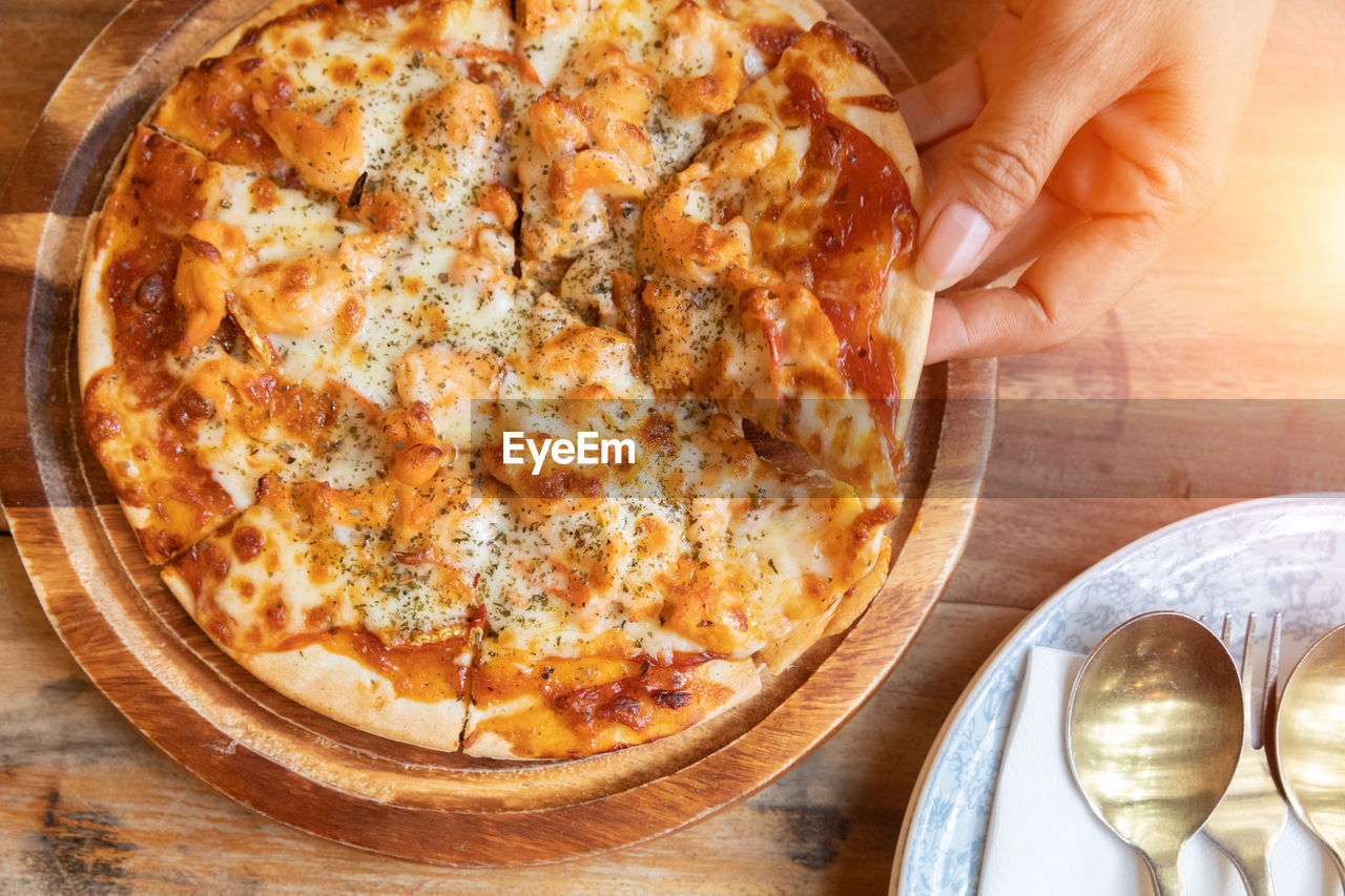food, human hand, kitchen utensil, human body part, food and drink, hand, eating utensil, table, pizza, indoors, directly above, spoon, high angle view, household equipment, fork, freshness, one person, plate, holding, healthy eating, body part, finger, table knife