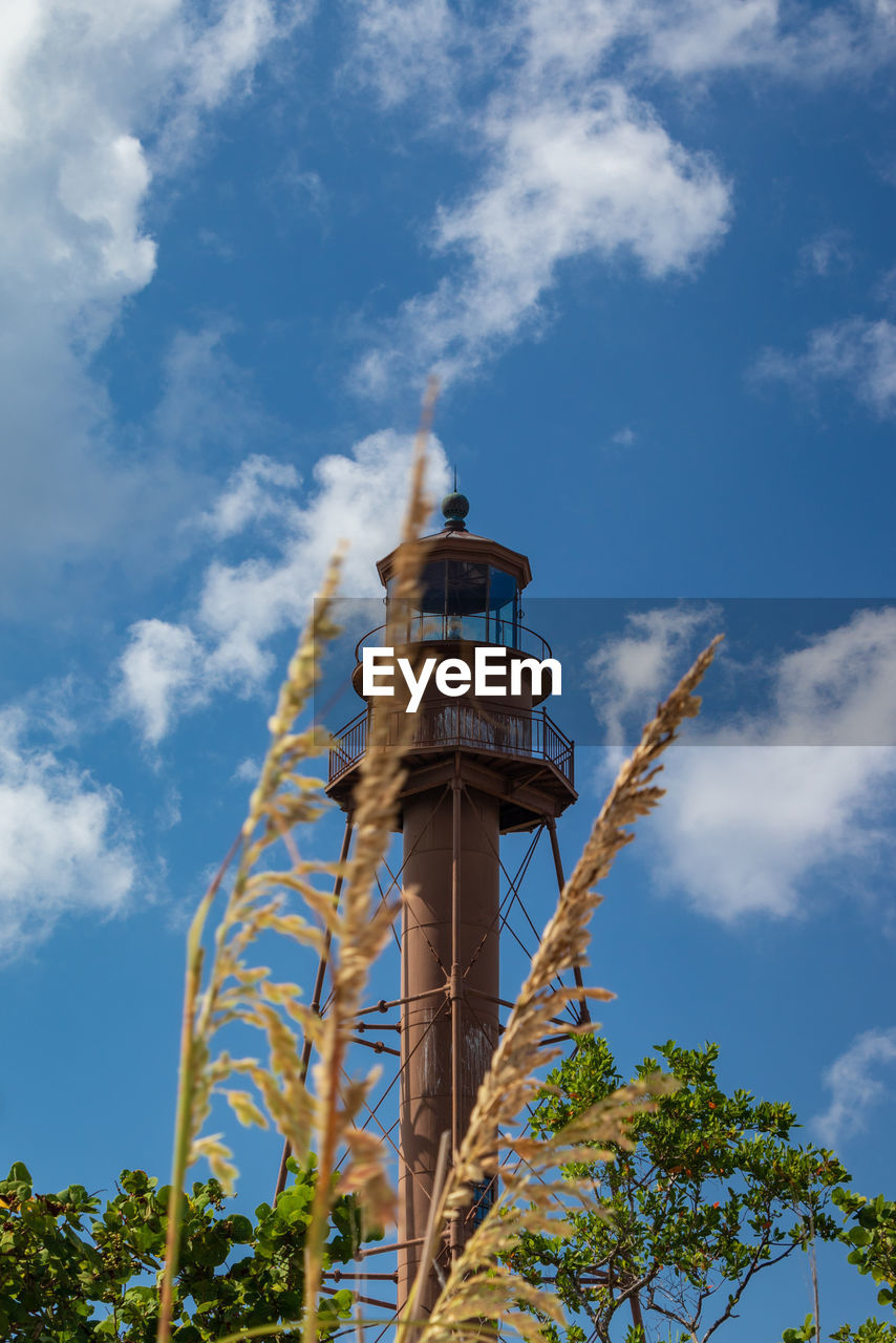 sky, cloud - sky, low angle view, architecture, built structure, building exterior, nature, day, no people, tree, plant, tower, tall - high, building, outdoors, blue, travel, lighthouse, city, tourism
