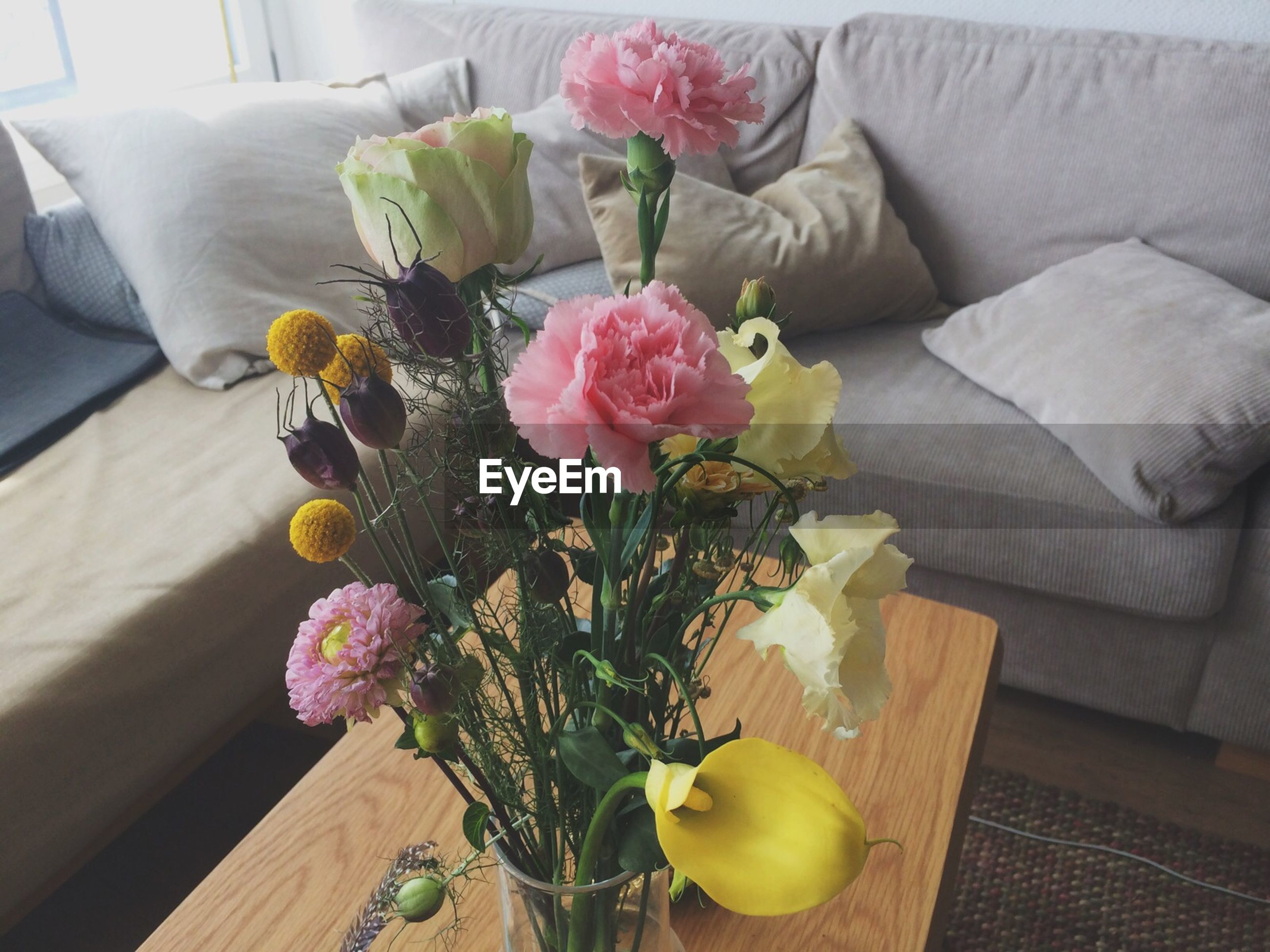 Flower vase kept on coffee table at home
