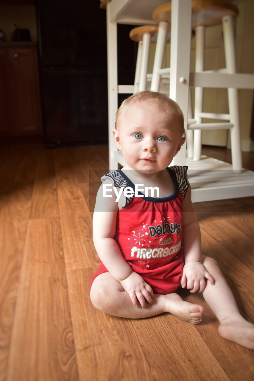 baby, young, indoors, real people, child, one person, babyhood, hardwood floor, cute, childhood, innocence, flooring, toddler, wood, sitting, portrait, lifestyles, home interior