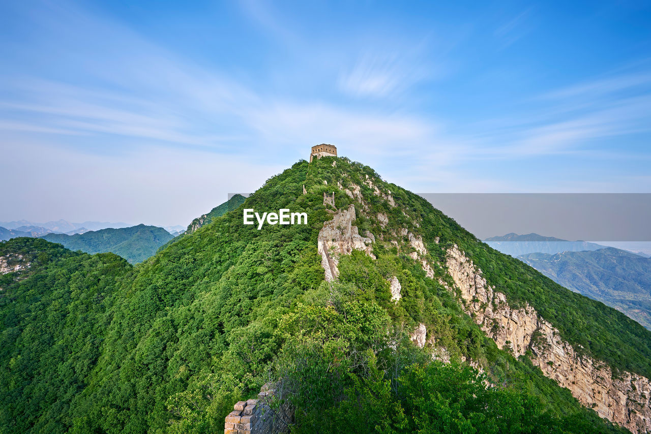 Scenic view of great wall of china on mountains against sky