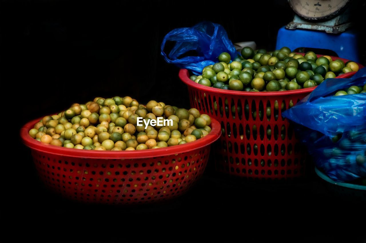 Limes In Basket At Market For Sale