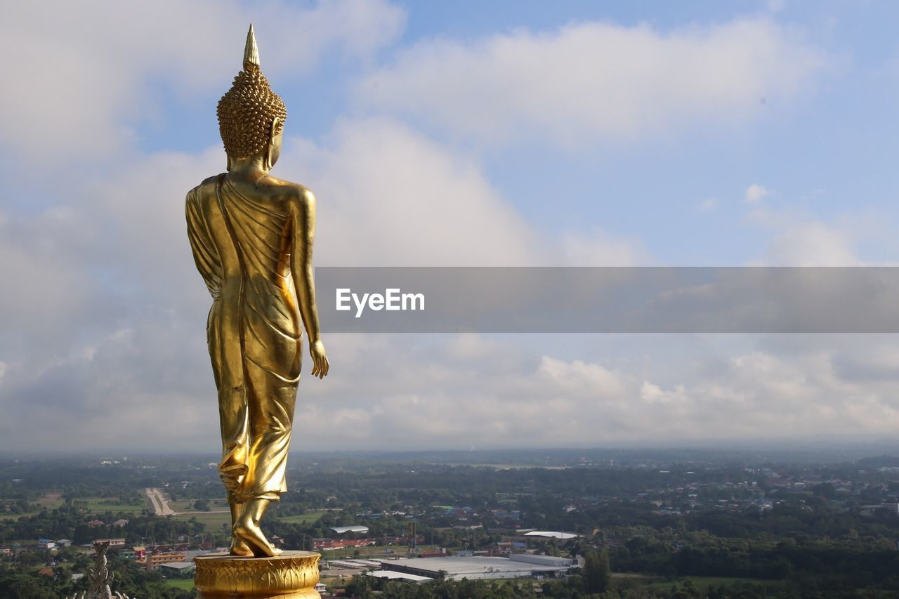 sculpture, statue, architecture, representation, sky, built structure, religion, human representation, art and craft, spirituality, belief, creativity, building, gold colored, cloud - sky, nature, male likeness, place of worship, no people, cityscape, angel, idol
