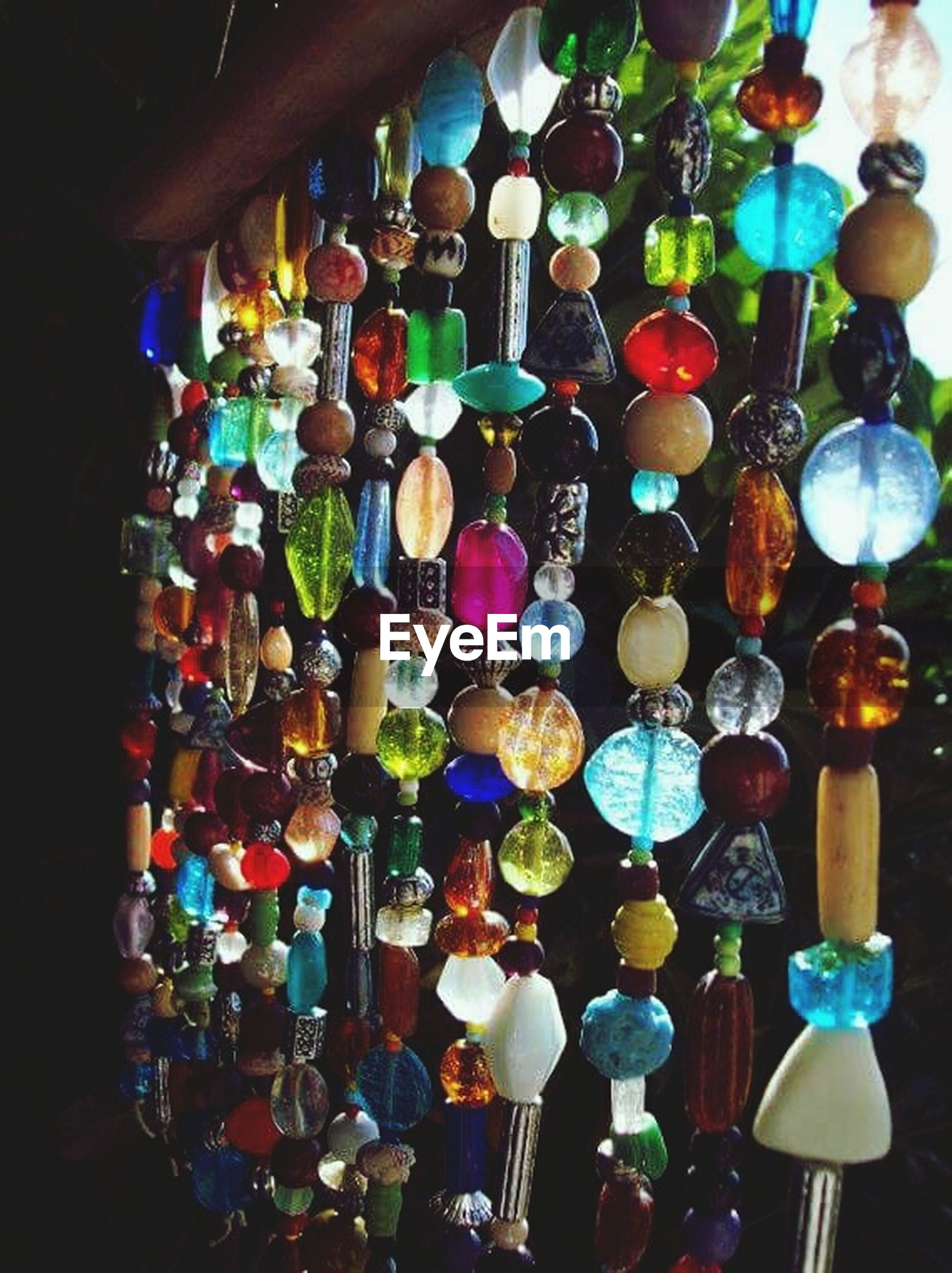 multi colored, large group of objects, abundance, hanging, indoors, decoration, variation, choice, in a row, lighting equipment, celebration, cultures, tradition, illuminated, colorful, arrangement, low angle view, retail, collection, close-up