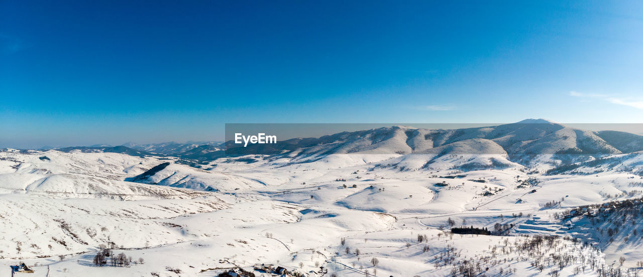 winter, snow, cold temperature, scenics - nature, sky, mountain, tranquil scene, beauty in nature, blue, tranquility, mountain range, non-urban scene, idyllic, environment, nature, day, landscape, snowcapped mountain, white color, no people, mountain peak