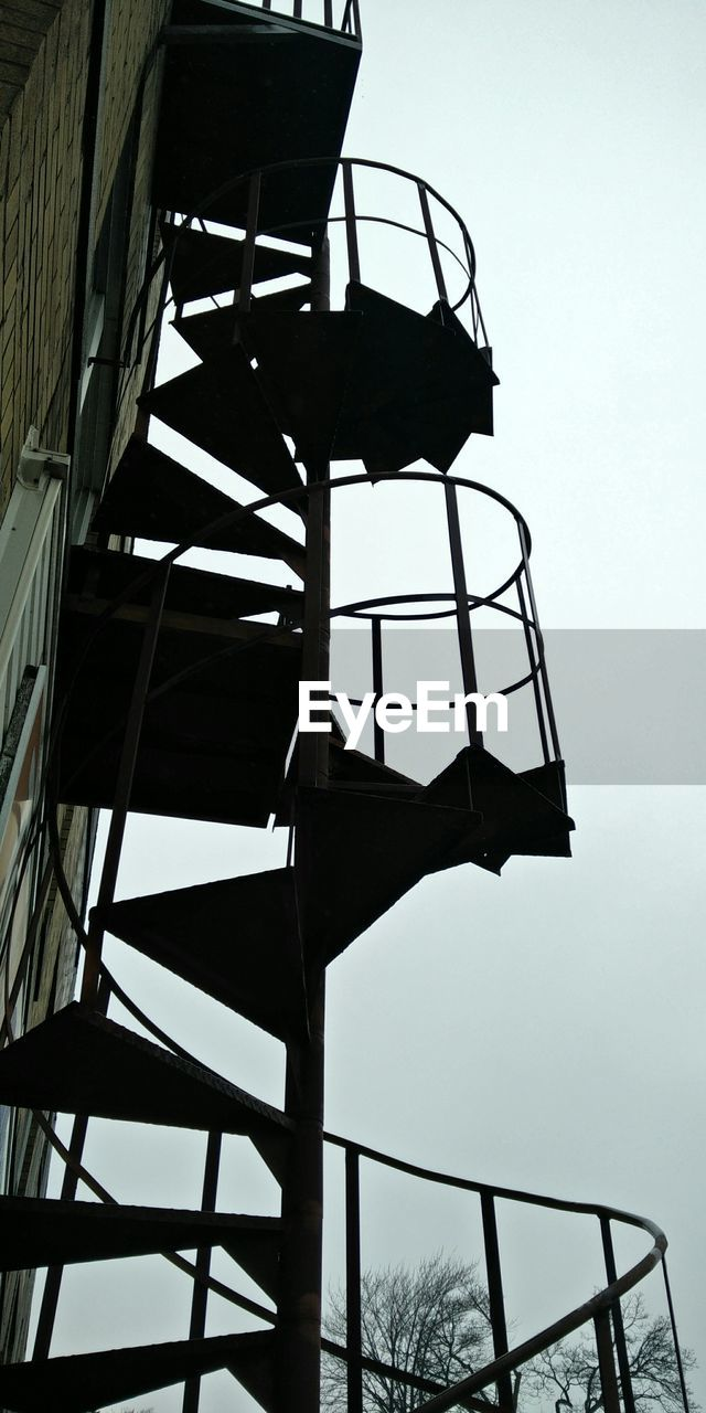 Low Angle View Of Spiral Staircase On Building Against Clear Sky