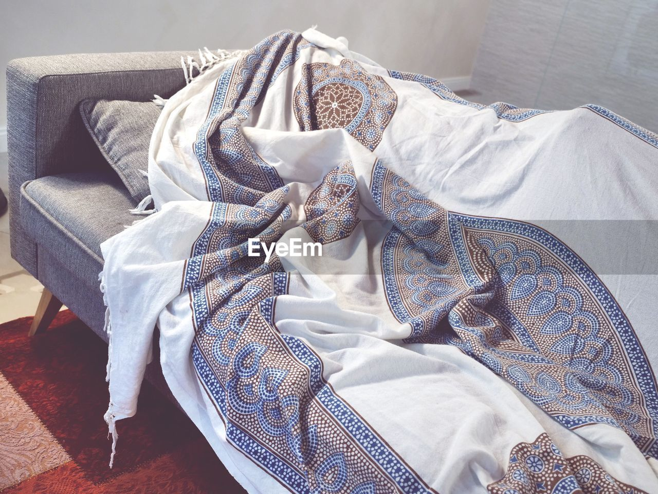 indoors, furniture, textile, bed, no people, relaxation, clothing, still life, pattern, high angle view, home interior, white color, blue, pillow, sheet, comfortable, linen, day, close-up, domestic room, floral pattern, jeans