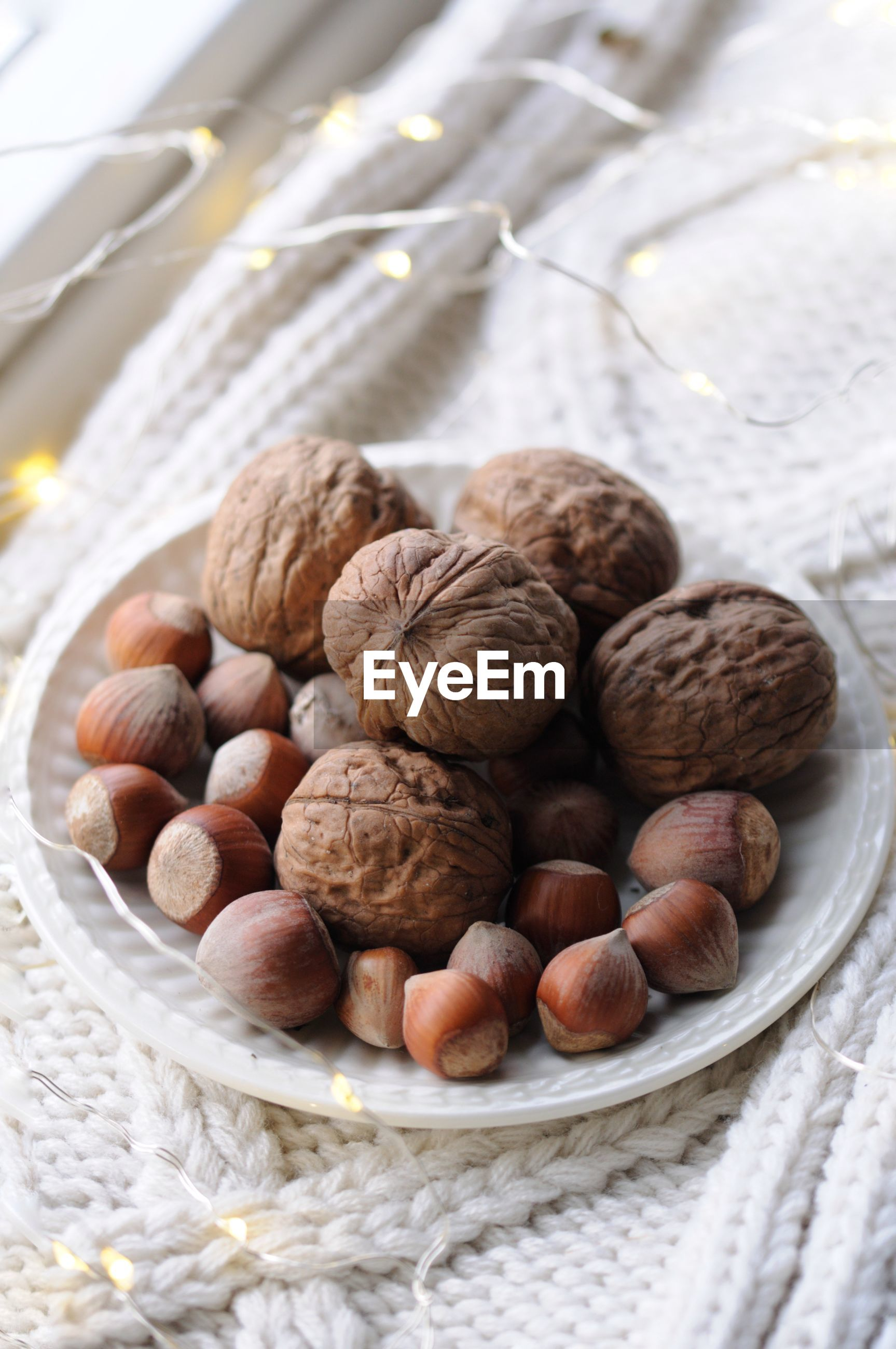 High angle view of walnuts in bowl on table