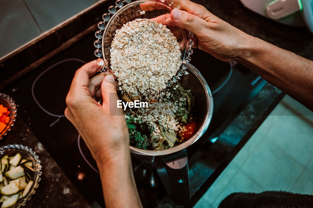 HIGH ANGLE VIEW OF PERSON PREPARING FOOD